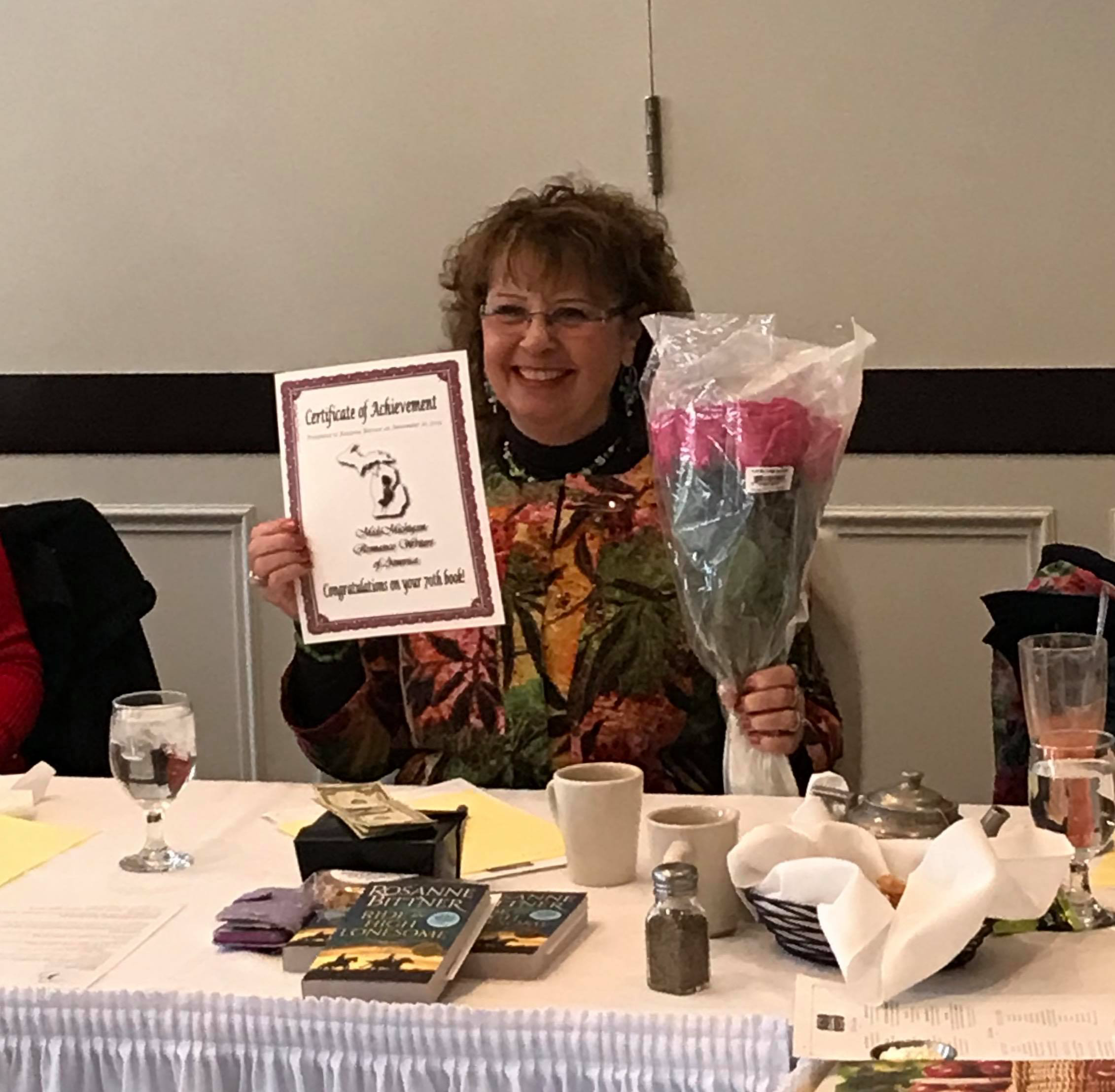 Long time member Rosanne Bittner was honored at our November meeting for publishing her 70th book! What an awesome achievement! Way to go, Rosanne.